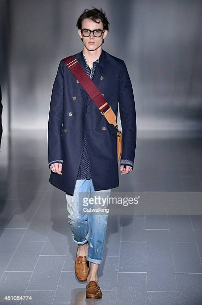 A model walks the runway at the Gucci Spring Summer 2015 fashion show during Milan Menswear Fashion Week on June 23 2014 in Milan Italy