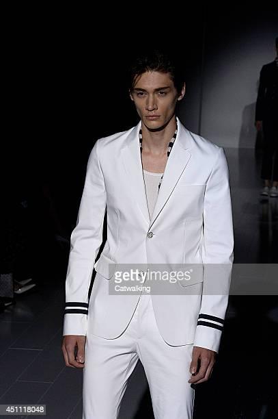 4beb8dd7a75 A model walks the runway at the Gucci Spring Summer 2015 fashion show  during Milan Menswear