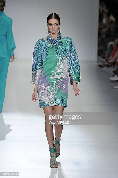 A model walks the runway at the Gucci Spring/Summer 2013 fashion show as part of Milan Womenswear Fashion Week on September 19 2012 in Milan Italy