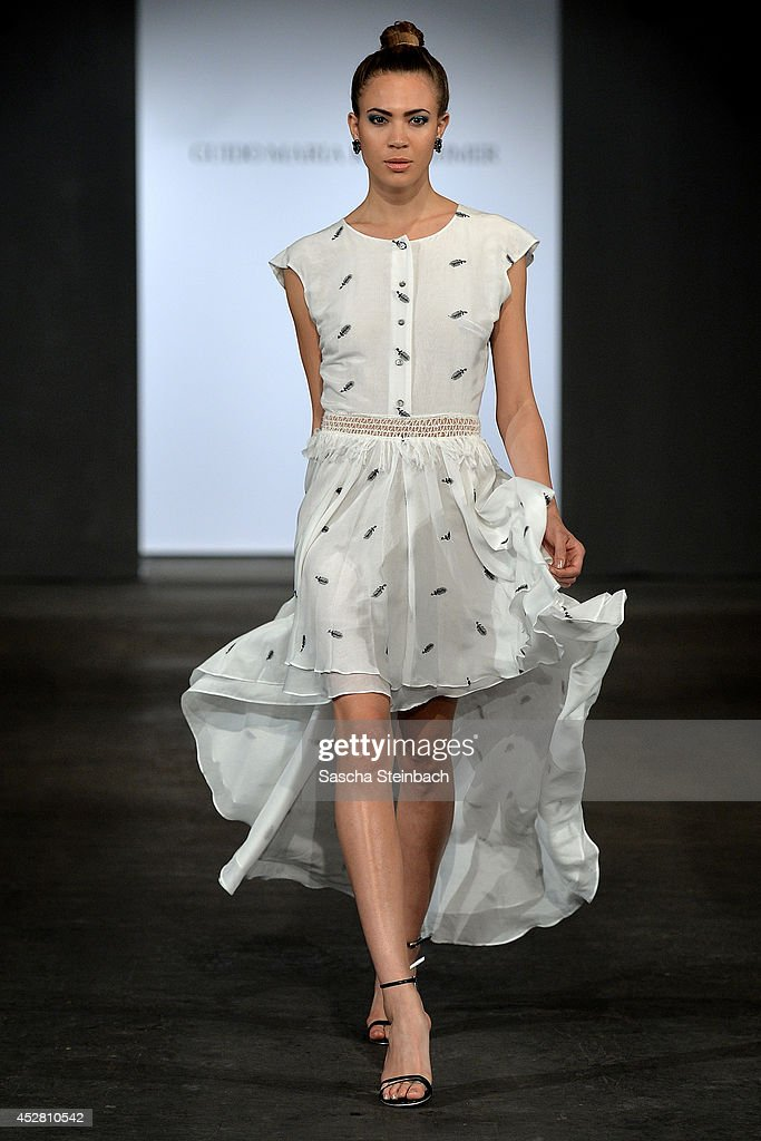 A model walks the runway at the Guido Maria Kretschmer Show during Platform Fashion Dusseldorf on July 27, 2014 in Duesseldorf, Germany.