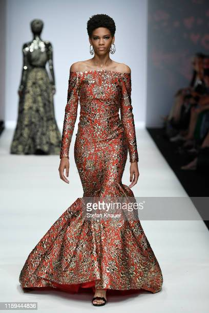 Model walks the runway at the Guido Maria Kretschmer show during the Berlin Fashion Week Spring/Summer 2020 at ewerk on July 01, 2019 in Berlin,...