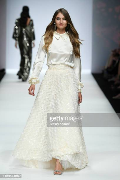 A model walks the runway at the Guido Maria Kretschmer show during the Berlin Fashion Week Spring/Summer 2020 at ewerk on July 01 2019 in Berlin...
