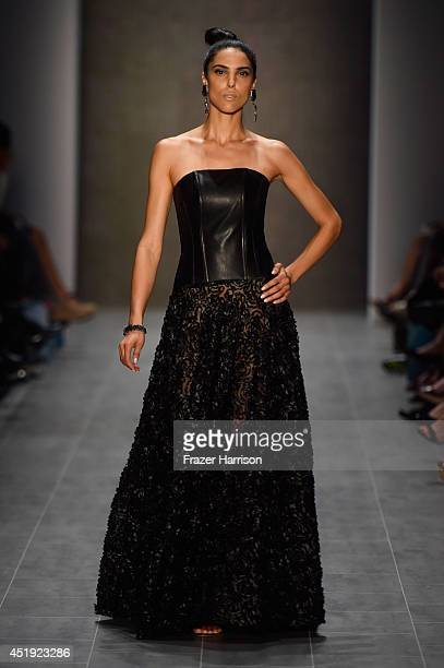 A model walks the runway at the Guido Maria Kretschmer show during the MercedesBenz Fashion Week Spring/Summer 2015 at Erika Hess Eisstadion on July...