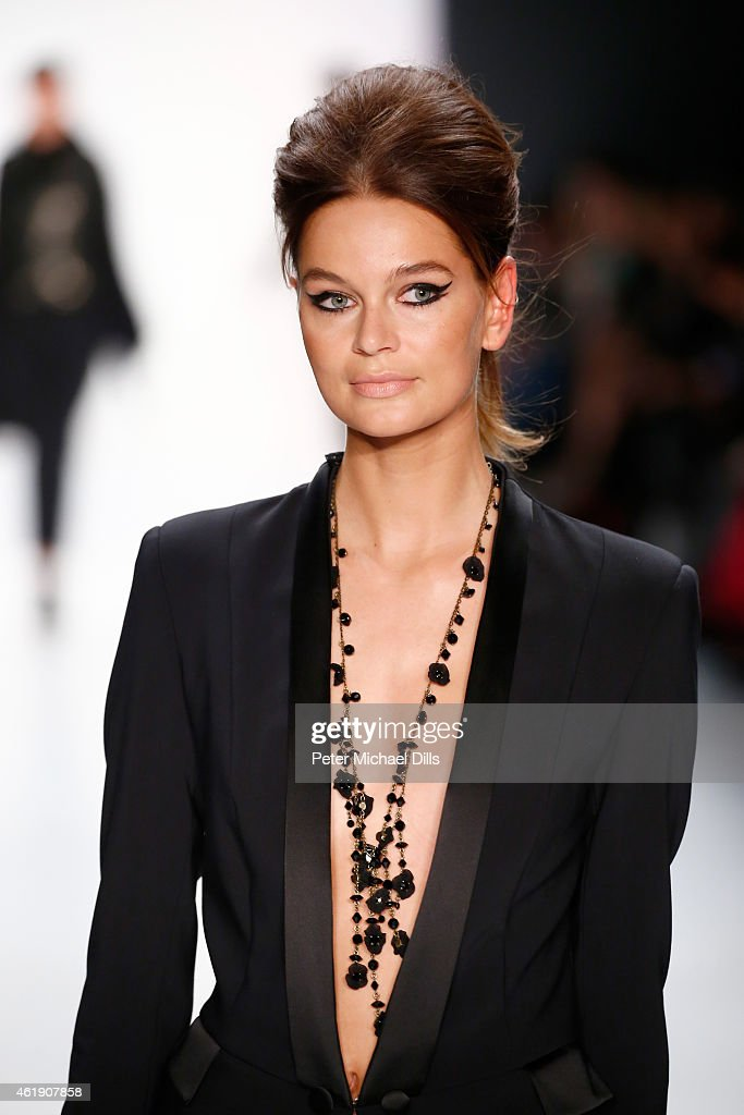 A model walks the runway at the Guido Maria Kretschmer show during the Mercedes-Benz Fashion Week Berlin Autumn/Winter 2015/16 at Brandenburg Gate on January 21, 2015 in Berlin, Germany.