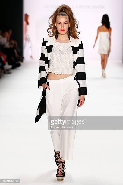 A model walks the runway at the Guido Maria Kretschmer show during the MercedesBenz Fashion Week Berlin Spring/Summer 2017 at Erika Hess Eisstadion...