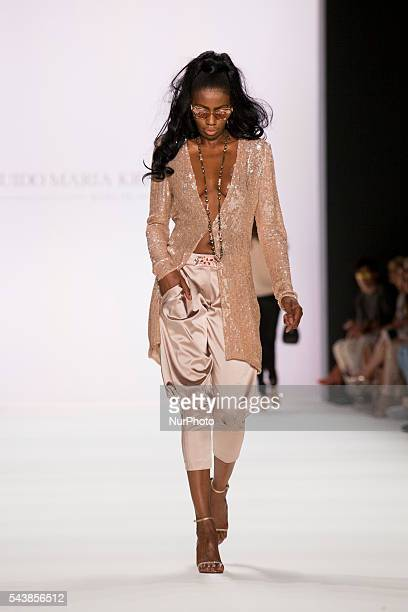 A model walks the runway at the Guido Maria Kretschmer show during the MercedesBenz Fashion Week Berlin Spring/Summer 2017 at Erika Hess Eisstadion...