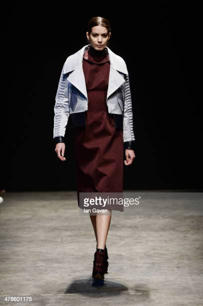 A model walks the runway at the Gulcin Cengel show during MBFWI presented by American Express Fall/Winter 2014 on March 14 2014 in Istanbul Turkey