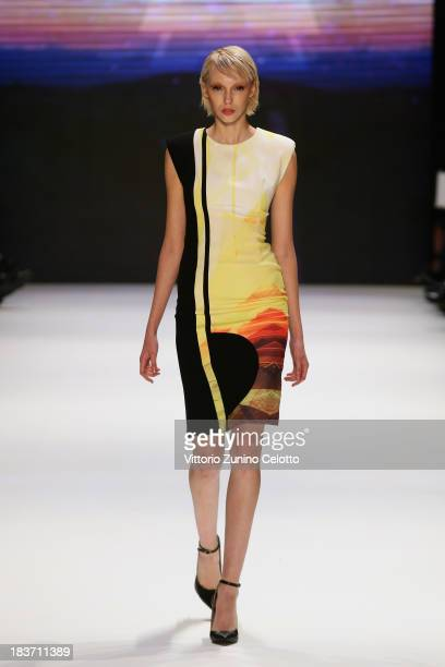 Model walks the runway at the Gunseli Turkay show during Mercedes-Benz Fashion Week Istanbul s/s 2014 presented by American Express on October 9,...