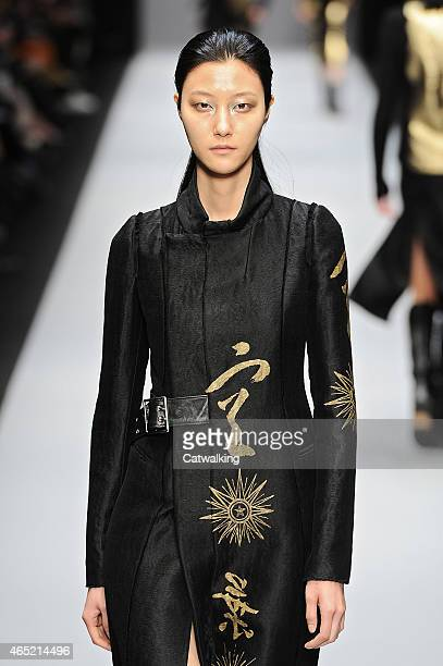 Model walks the runway at the Guy Laroche Autumn Winter 2015 fashion show during Paris Fashion Week on March 4, 2015 in Paris, France.