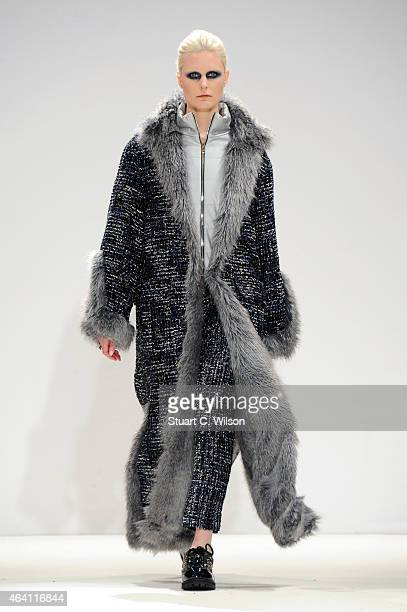 A model walks the runway at the Gyo Yuni Kimchoe show during London Fashion Week Fall/Winter 2015/16 at Fashion Scout Venue on February 22 2015 in...
