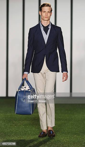 A model walks the runway at the Hackett show during the London Collections Men SS15 on June 16 2014 in London England