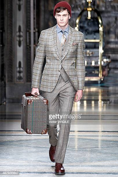 A model walks the runway at the Hackett show during The London Collections Men Autumn/Winter 2014 at Freemasons' Hall on January 7 2014 in London...