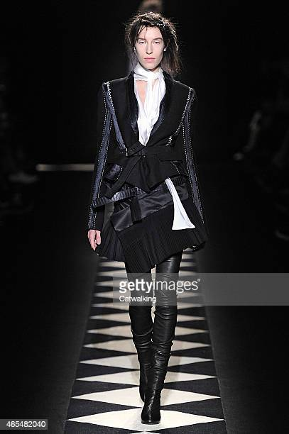 A model walks the runway at the Haider Ackermann Autumn Winter 2015 fashion show during Paris Fashion Week on March 7 2015 in Paris France
