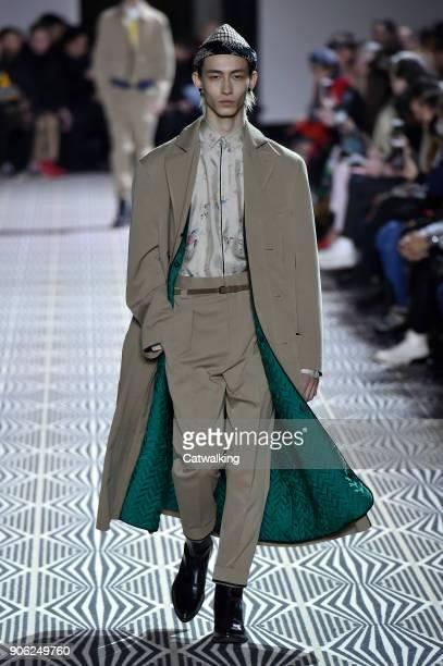 d3d64b9af16 A model walks the runway at the Haider Ackermann Autumn Winter 2018 fashion  show during Paris. Palm Angels - Mens Spring ...