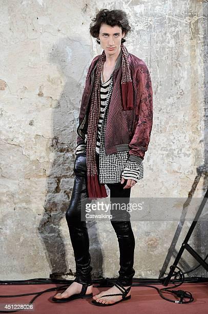 Model walks the runway at the Haider Ackermann Spring Summer 2015 fashion show during Paris Menswear Fashion Week on June 25, 2014 in Paris, France.