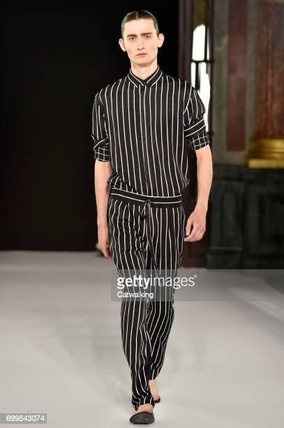 A model walks the runway at the Haider Ackermann Spring Summer 2018 fashion show during Paris Menswear Fashion Week on June 21 2017 in Paris France