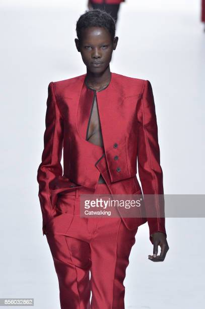 Model walks the runway at the Haider Ackermann Spring Summer 2018 fashion show during Paris Fashion Week on September 30, 2017 in Paris, France.