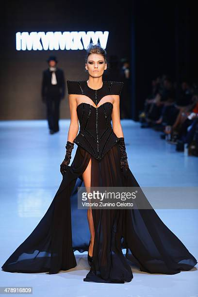A model walks the runway at the Hakan Akkaya show during MBFWI presented by American Express Fall/Winter 2014 on March 15 2014 in Istanbul Turkey