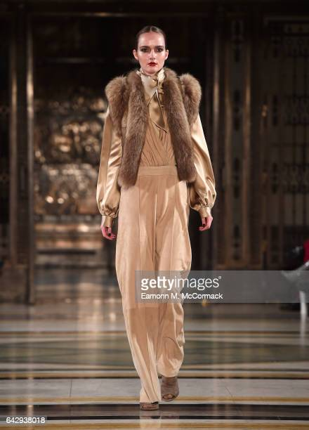 A model walks the runway at the Hallie Sara show during the London Fashion Week February 2017 collections on February 19 2017 in London England