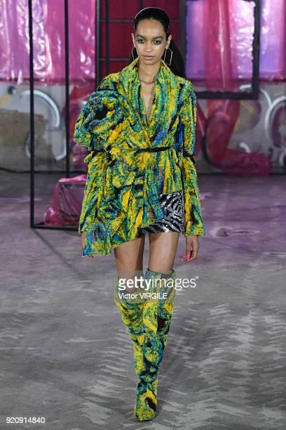 A model walks the runway at the Halpern Ready to Wear Fall/Winter 20182019 fashion show during London Fashion Week February 2018 on February 17 2018...