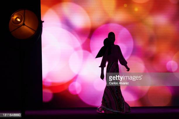 Model walks the runway at the Hannibal Laguna fashion show during Mercedes Benz Fashion Week Madrid April 2021 at Ifema on April 09, 2021 in Madrid,...