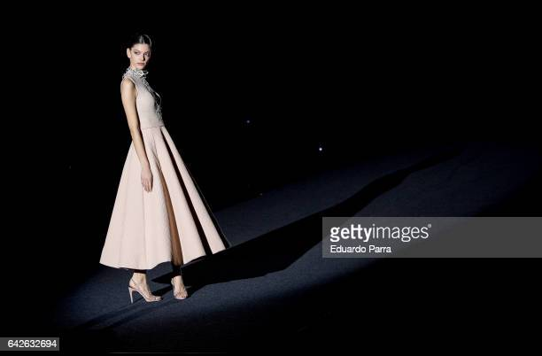 A model walks the runway at the Hannibal Laguna show during the MercedesBenz Madrid Fashion Week Autumn/Winter 2017 at Ifema on February 18 2017 in...