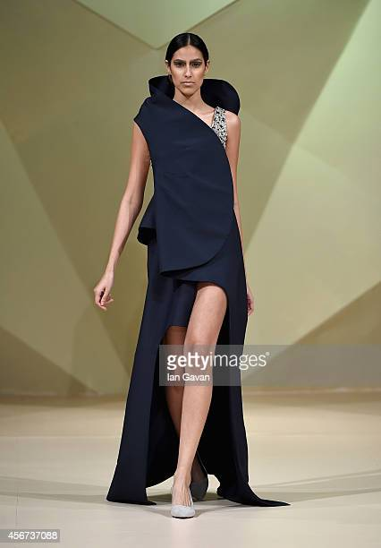A model walks the runway at the Hashe show during Fashion Forward at Madinat Jumeirah on October 6 2014 in Dubai United Arab Emirates