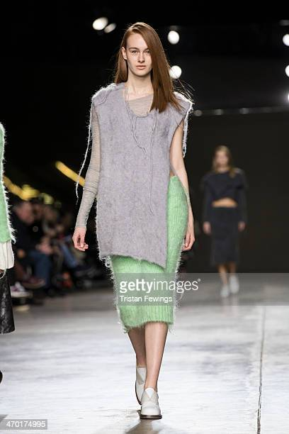 A model walks the runway at the Helen Lawrence show during Fashion East at London Fashion Week AW14 at Tate Modern on February 18 2014 in London...