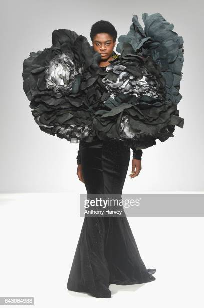 A model walks the runway at the Hellavagirl show during the London Fashion Week February 2017 collections on February 20 2017 in London England