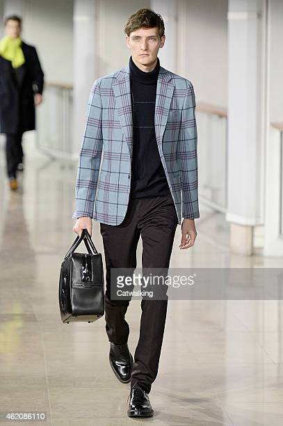 A model walks the runway at the Hermes Autumn Winter 2015 fashion show during Paris Menswear Fashion Week on January 24 2015 in Paris France