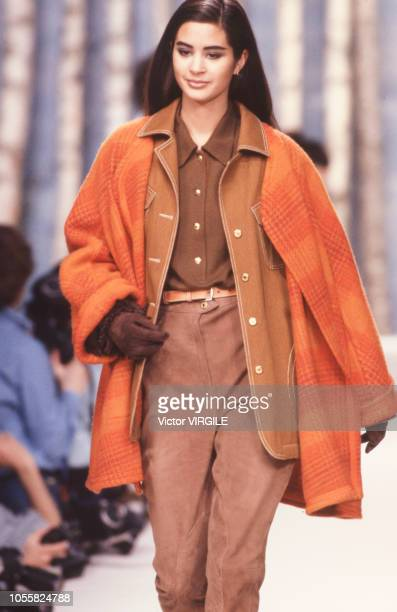 Model walks the runway at the Hermes Ready to Wear Fall/Winter 1990-1991 fashion show during the Paris Fashion Week in March, 1990 in Paris, France.