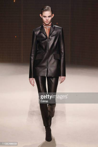 A model walks the runway at the Hermes show at Paris Fashion Week Autumn/Winter 2019/20 on March 2 2019 in Paris France