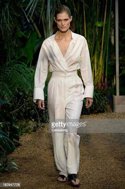Model walks the runway at the Hermes Spring Summer 2014 fashion show during Paris Fashion Week on October 2, 2013 in Paris, France.