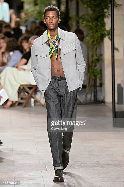 A model walks the runway at the Hermes Spring Summer 2016 fashion show during Paris Menswear Fashion Week on June 27 2015 in Paris France
