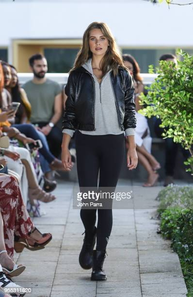 A model walks the runway at the Heroine Sport Fashion Show At The Retreat on May 5 2018 in Miami Florida