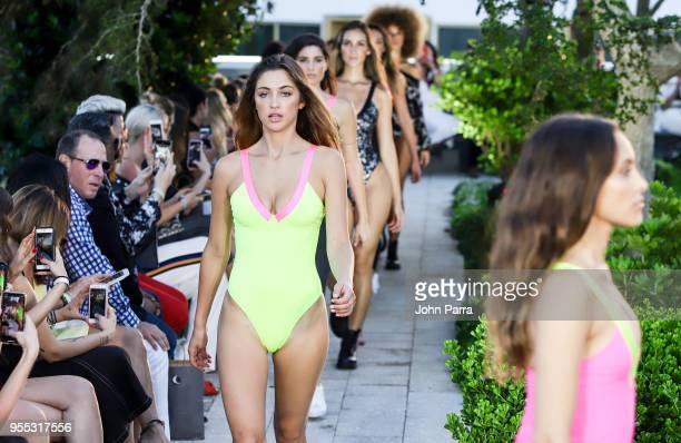 A model walks the runway at the Heroine Sport For Tracy Anderson Fashion Show At The Retreat on May 5 2018 in Miami Florida