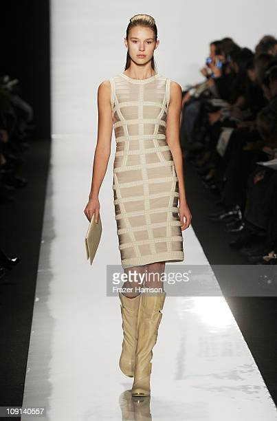 A model walks the runway at the Herve Leger by Max Azria Fall 2011 fashion show during MercedesBenz Fashion Week at The Theatre at Lincoln Center on...