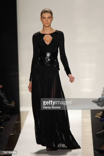 Model walks the runway at the Herve Leger by Max Azria Fall 2012 fashion show during Mercedes-Benz Fashion Week at The Theatre at Lincoln Center on...