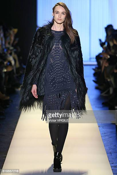 A model walks the runway at the Herve Leger By Max Azria Fall/Winter 2016 fashion show during New York Fashion Week on February 13 2016 in New York...