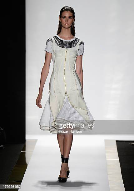 A model walks the runway at the Herve Leger By Max Azria fashion show during MercedesBenz Fashion Week Spring 2014 at The Theatre at Lincoln Center...