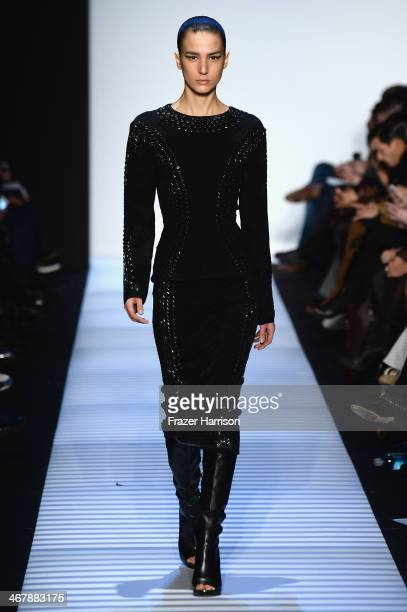 Model walks the runway at the Herve Leger By Max Azria fashion show during Mercedes-Benz Fashion Week Fall 2014 at The Theatre at Lincoln Center on...