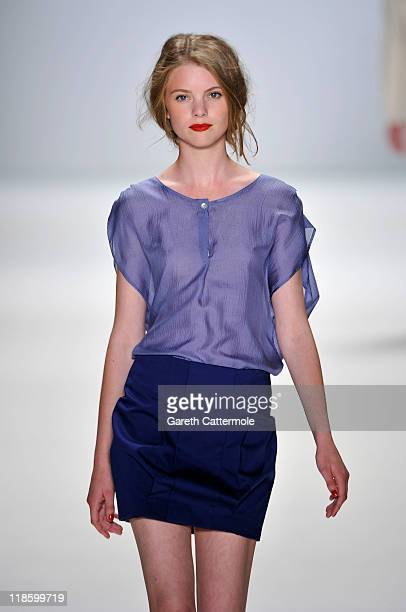 A model walks the runway at the Hien Le Show during MercedesBenz Fashion Week Berlin Spring/Summer 2012 at the Brandenburg Gate on July 9 2011 in...