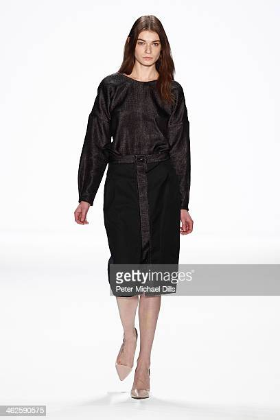 A model walks the runway at the Hien Le show during MercedesBenz Fashion Week Autumn/Winter 2014/15 at Brandenburg Gate on January 14 2014 in Berlin...