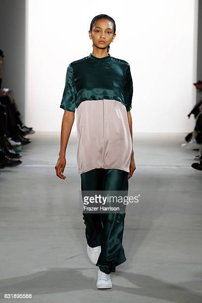 A model walks the runway at the Hien Le show during the MercedesBenz Fashion Week Berlin A/W 2017 at Kaufhaus Jandorf on January 17 2017 in Berlin...