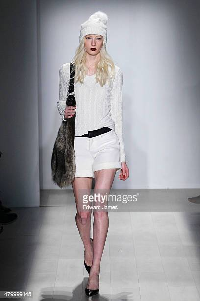 A model walks the runway at the Hilary MacMillan fashion show during World Mastercard fashion week on March 21 2014 in Toronto Canada