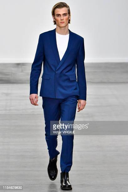 Model walks the runway at the HLA x AEX by JD.COM, INC Ready to Wear Spring/Summer 2020 fashion show during London Fashion Week Men's June 2019 on...