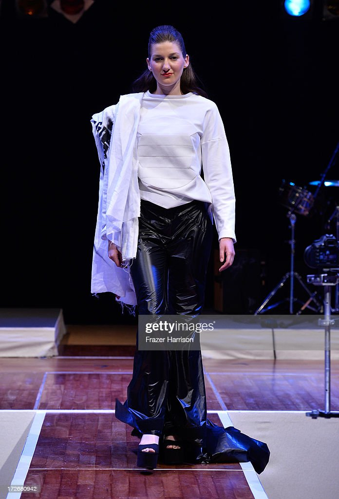 A model walks the runway at the Hochschule Pforzheim Show during Mercedes-Benz Fashion Week Spring/Summer 2014 at Landesvertretung Baden-Wuerttemberg on July 4, 2013 in Berli