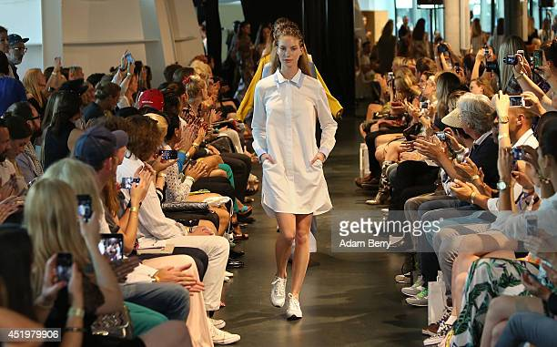 A model walks the runway at the Holy Ghost show during the MercedesBenz Fashion Week Spring/Summer 2015 at Supermarket Concept Space At Bikini Berlin...