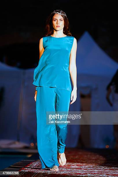 A model walks the runway at the Holy Ghost show during the MercedesBenz Fashion Week Berlin Spring/Summer 2016 at on July 8 2015 in Berlin Germany