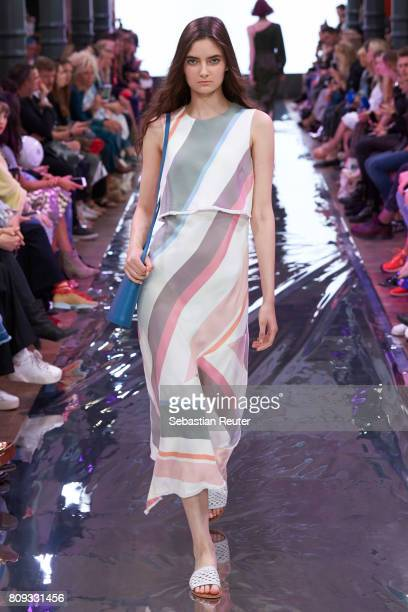 A model walks the runway at the Holy Ghost show during the MercedesBenz Fashion Week Berlin Spring/Summer 2018 at Heeresbaeckerei on July 5 2017 in...